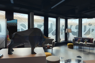 Interior at an ABOUT YOU IPO with cardboard animal as decorative element and lounge furniture